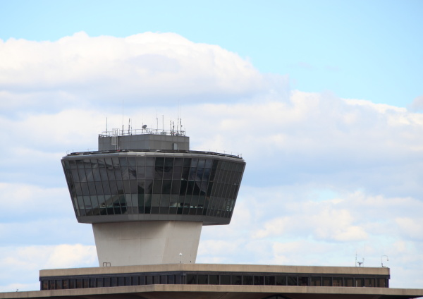 airport control tower with clouds and
