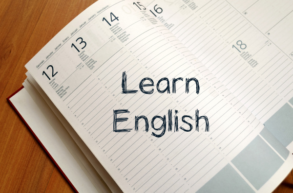 learn english write on notebook