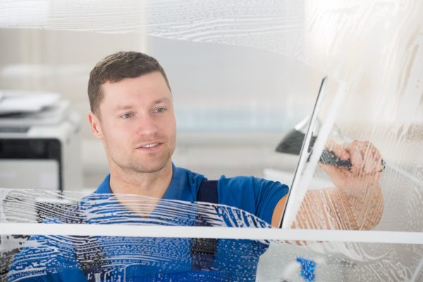 worker, cleaning, soap, sud, on, window - 15865871