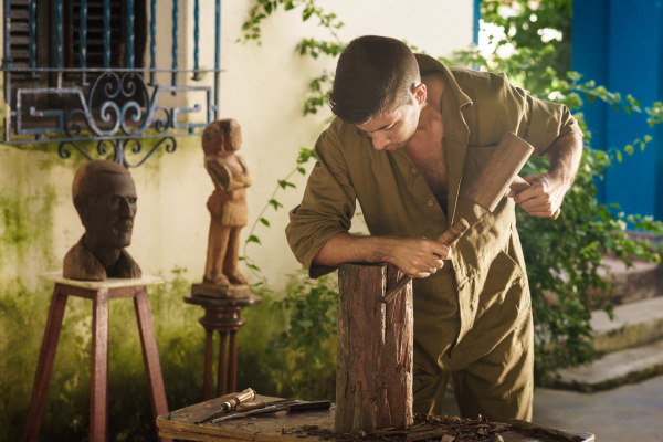 young sculptor artist working and sculpting