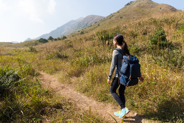 young woman go hiking