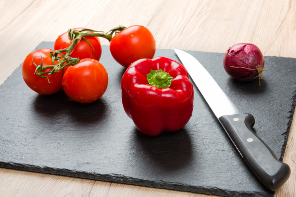 black cutting board with knife and