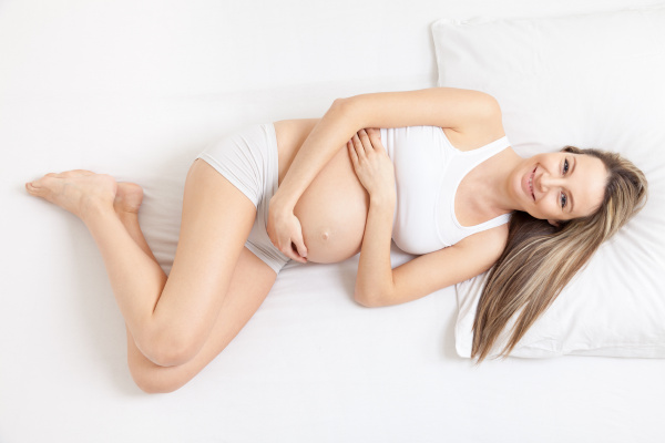 pregnant, woman, relaxing, on, the, bed - 16324339