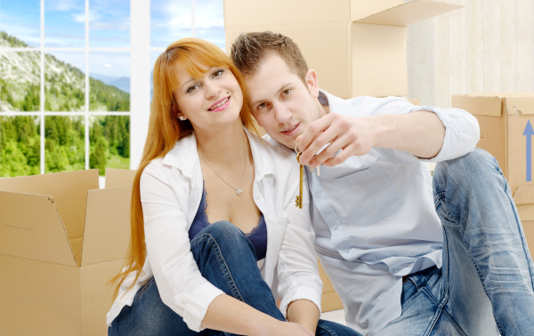 happy, couple, celebrating, their, new, home - 16357253