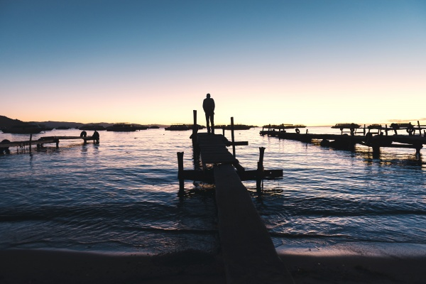bolivia man standing on wooden boardwalk