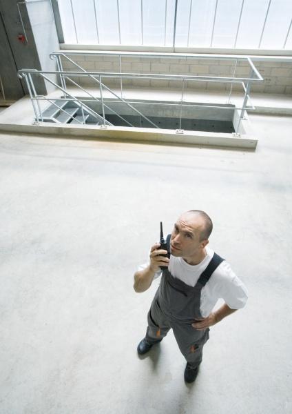 factory worker using walkie talkie