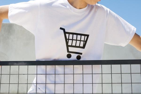 teenage boy wearing tee shirt printed