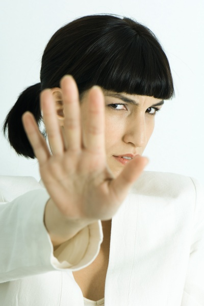 woman holding out palm of hand