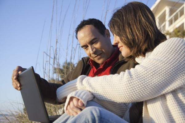 couple using laptop computer at the