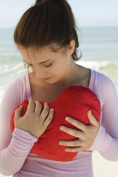 preteen girl holding heart shaped stuffed