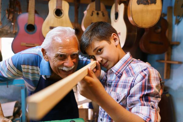 old man luter teaching grandson boy