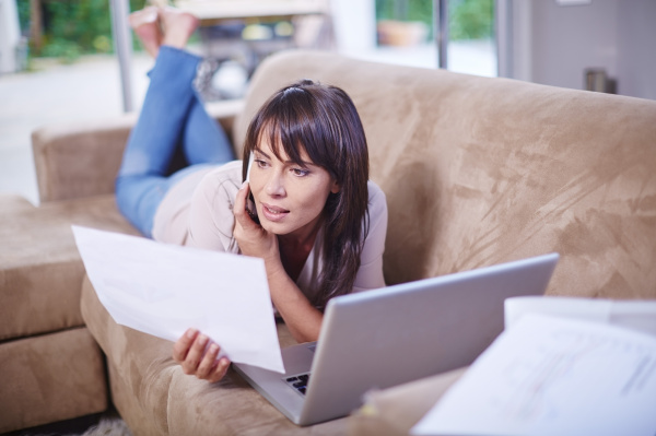 woman lying on couch looking at