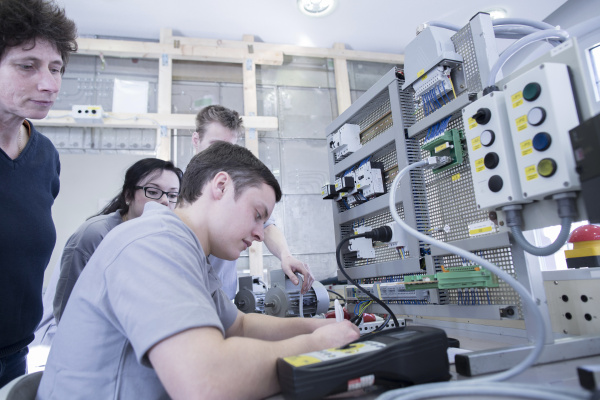 students and teacher at electronics vocational