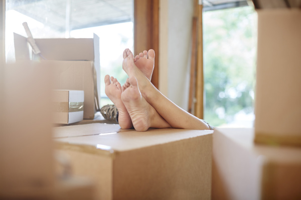 couple moving house feet on a