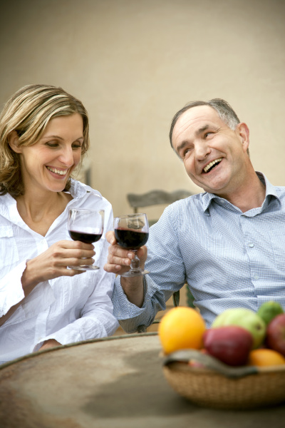 two friends toasting with red wine