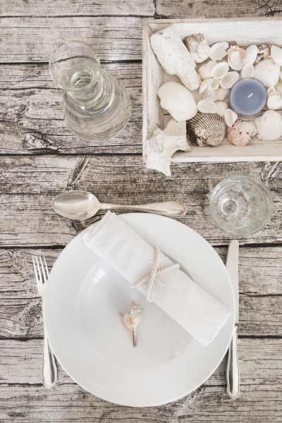 place setting with water carafe on