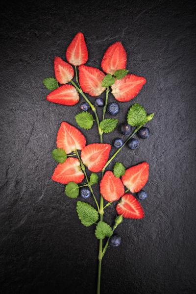 symbolic flower shaped of sliced strawberries