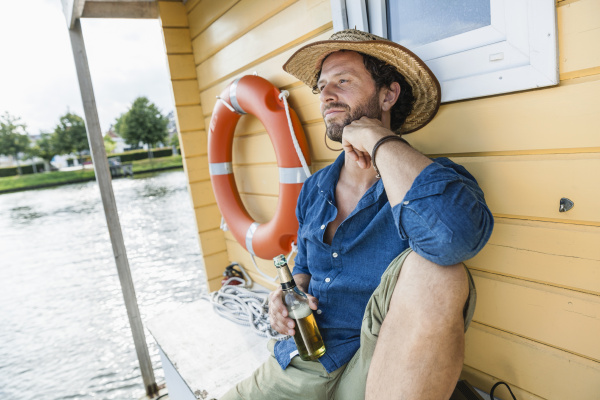 relaxed man on a house boat