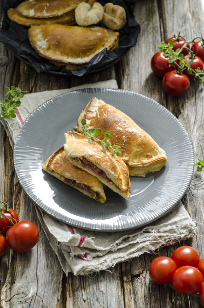 calzone stuffed with tomatoes salami and