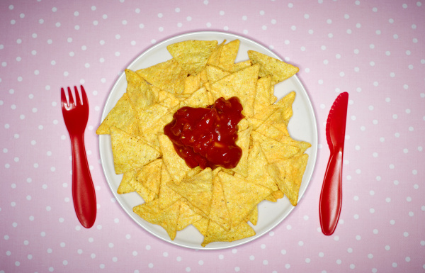 plate of cheese nachos with salsa