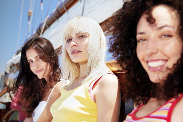 three relaxed young women on a