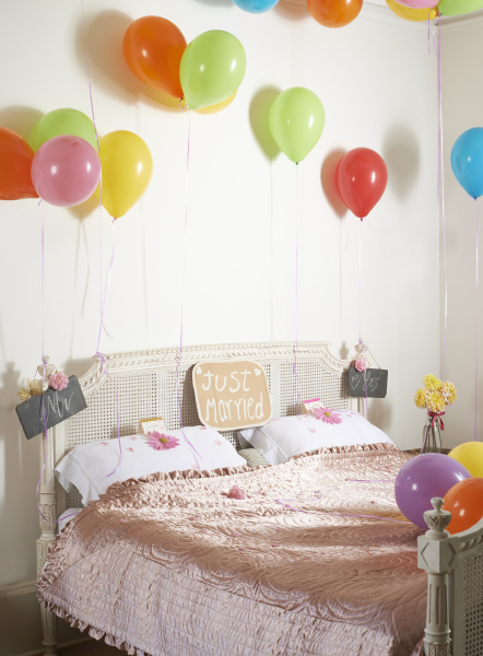 colorful balloons over marriage bed