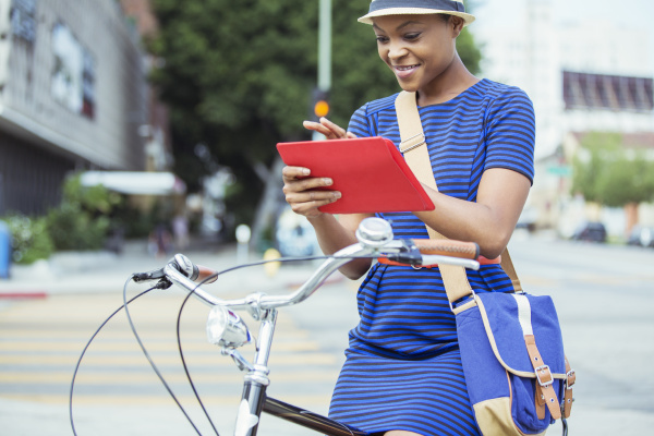 casual businesswoman using digital tablet on