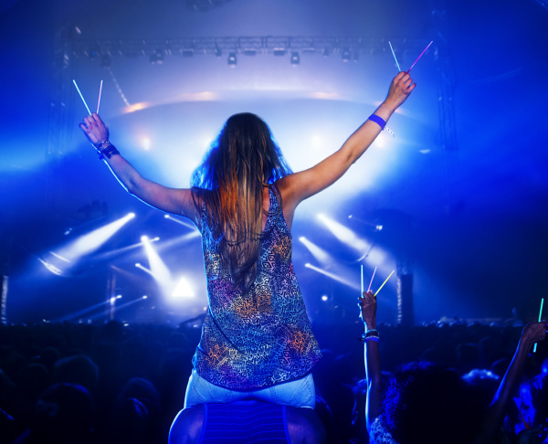 cheering woman with glow sticks on