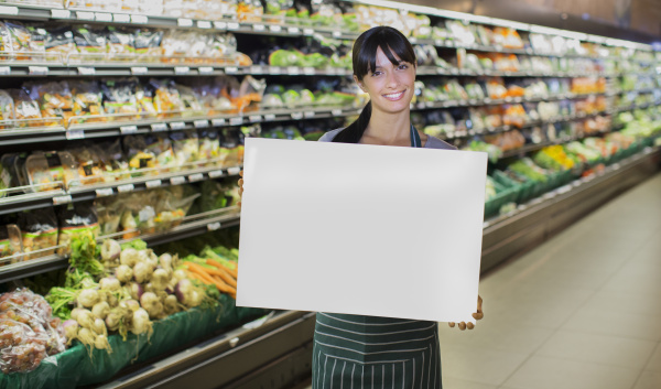 clerk holding blank card in produce