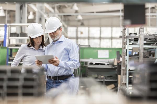 engineers using digital tablet in steel
