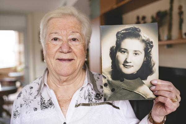 portrait of senior woman showing an