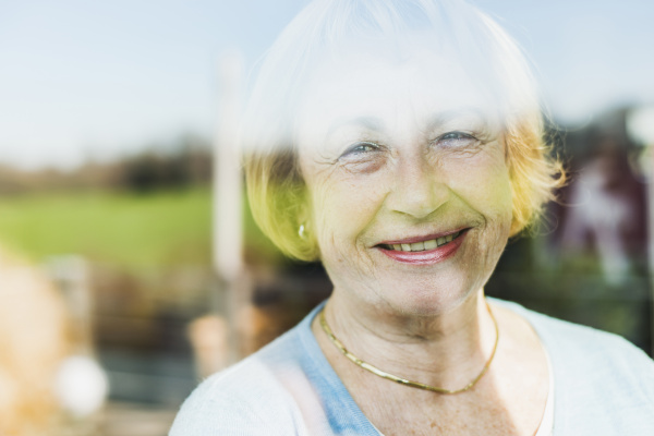 portrait of smiling senior woman behind