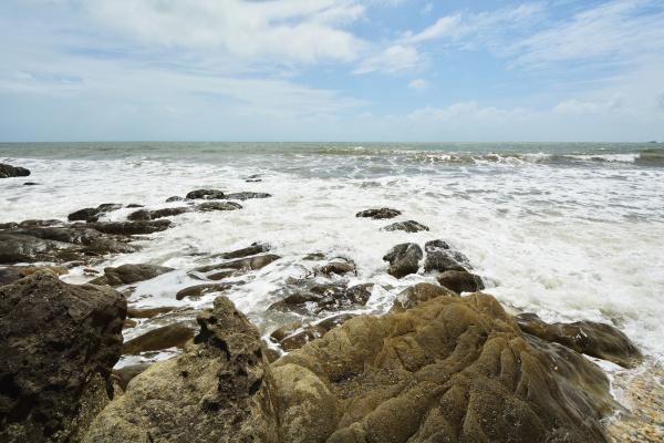 stone beach with rough sea