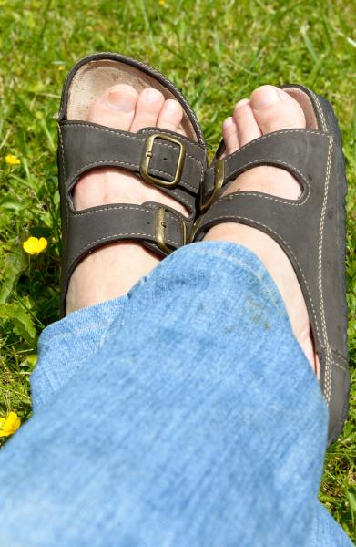 man feet on grass background