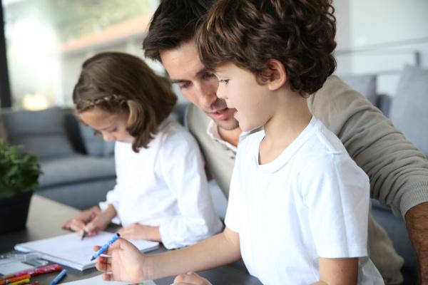 daddy having fun with kids drawing