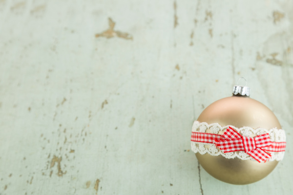 christmas balls on rustic wooden board