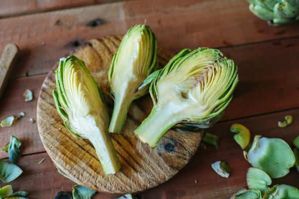 sliced artichoke on wood