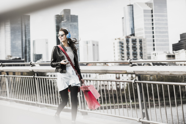young woman walking in the city