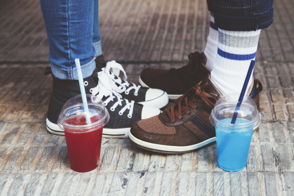plastic cups with soft drinks standing