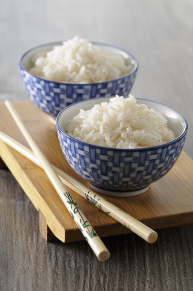cooked rice in oriental bowls with