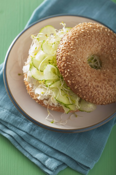 a bagel filled with cucumber feta