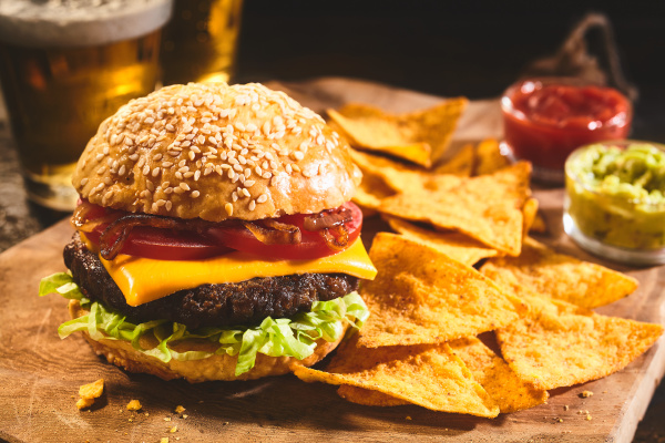 burger with beer and nachos appetizers