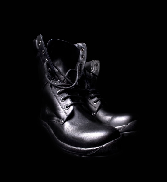 a pair of black leather military