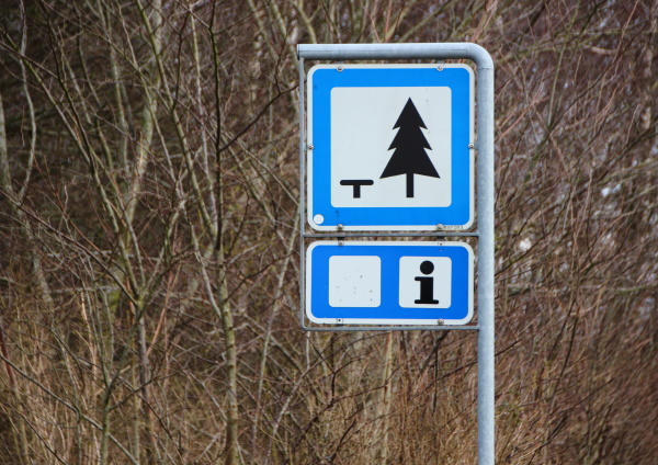 rest area sign with tree and