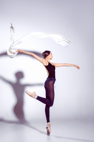 ballerina in black outfit posing on