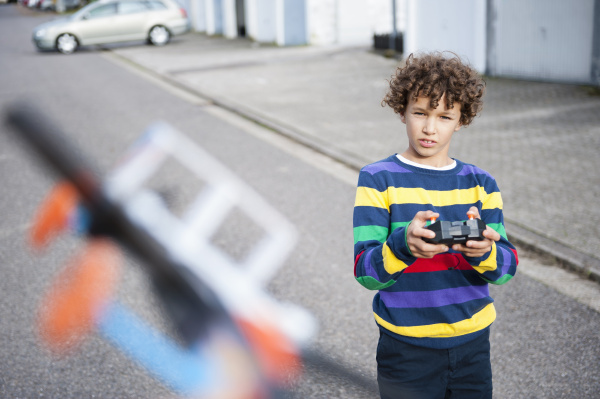 boy playing with flying with radio