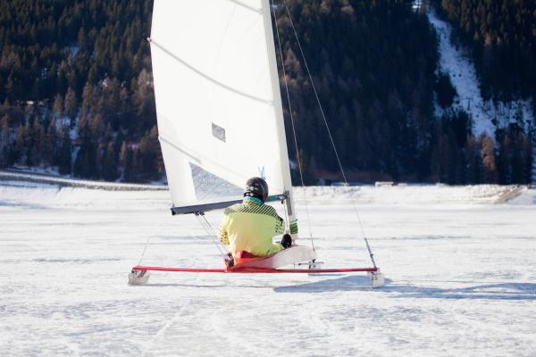 ice sailor sledding across frozen lake