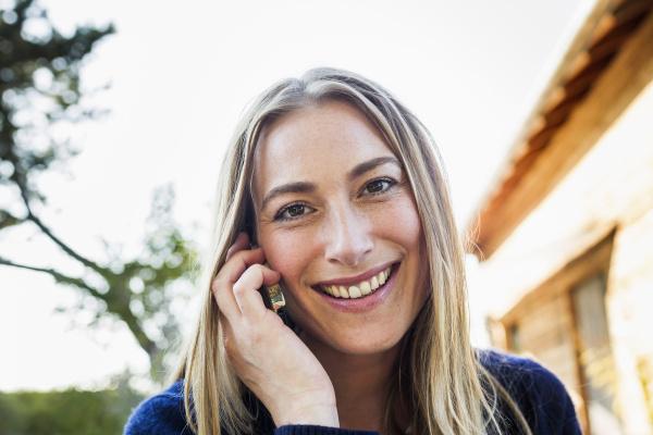 mid adult woman on smartphone