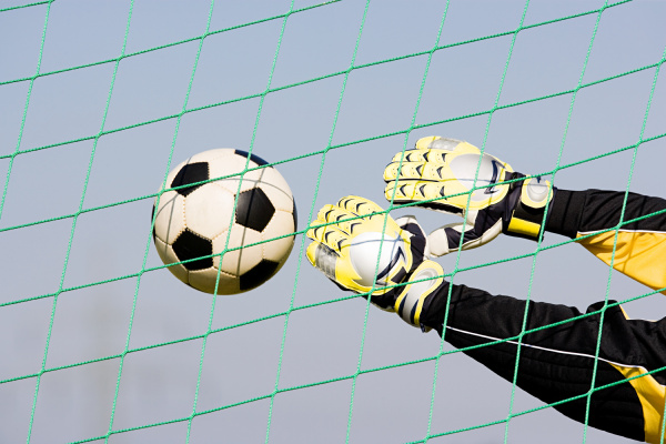 goalkeeper making a save
