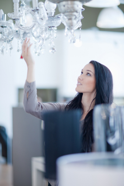 woman shopping for chandelier in store